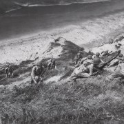 Troops crawl up a hill