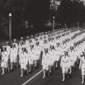 Lines of nurses dressed in white